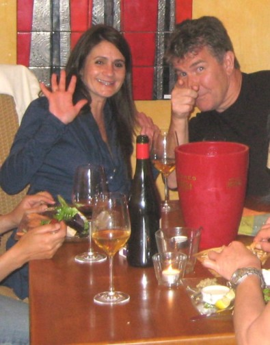 Guests from London enjoying a local wine bar - he proposed marriage soon after their vacation here!