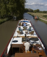 Our friends' beautifully-restored 100 year old luxury barge - just for you!
