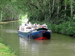 Luxury Barge E cruising the Canal du Midi, South of France
