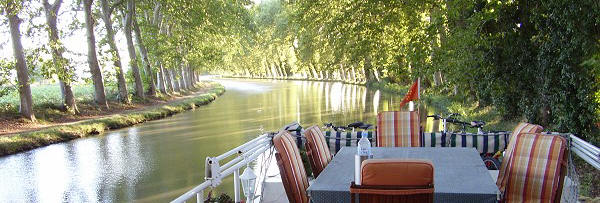 Luxury cruise of the Canal du Midi, historic European river barge, South of France, private owners